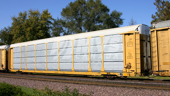 Enclosed Rail Car designed to ship vehicles