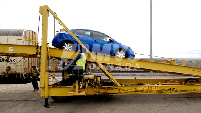 A car being unloaded from the train