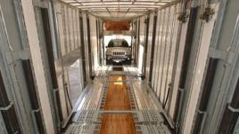 Loading a vehicle into the enclosed trailer