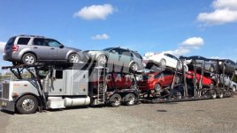 A truck load of vehicles being shipped to Toronto
