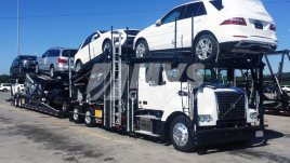 New vehicles loaded on a car hauler
