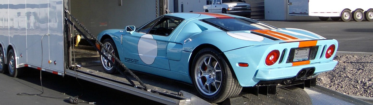 Driving a Ford GT up long low-angle ramp into an enclosed transport trailer
