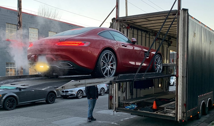 Mercedes-Benz safely being loaded into an enclosed trailer