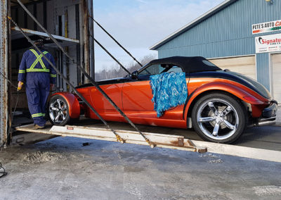 Orange Plymouth Prowler being loaded into trailer