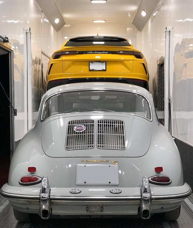 Porsche 356C and Lamborghini Urus inside enclosed trailer for transport