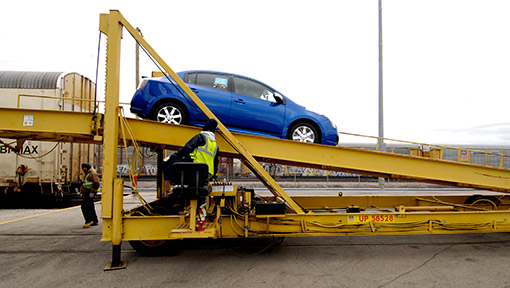 Car being unloaded from rail car