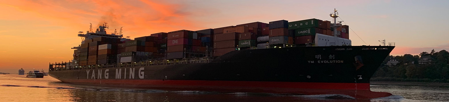 Large container ship leaving port