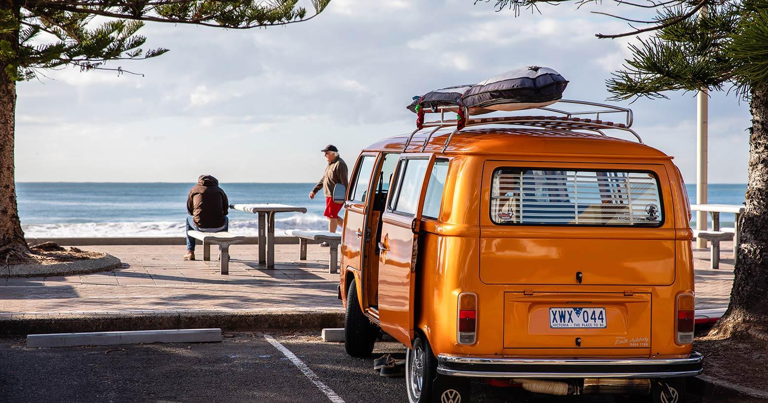 Volkswagen camper van by the beach in Australia